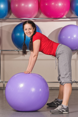 beautiful woman with fitness ball at gym photo