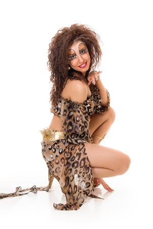 Sitting Wild Fashion woman on white background photo