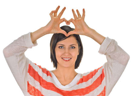 young woman showing heart symbol. white background photo