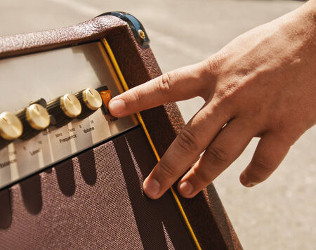amp: turning on guitar amplifier with hand finger