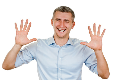Portrait of happy smiling man showing ten fingers, isolated over white background Stockfoto