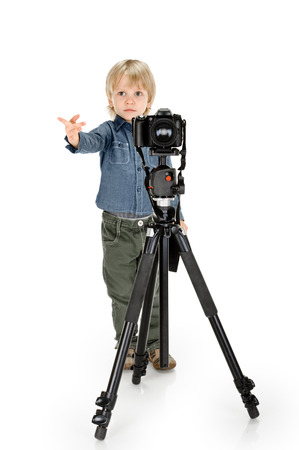 casua: little boy with camera on tripod full length on white background