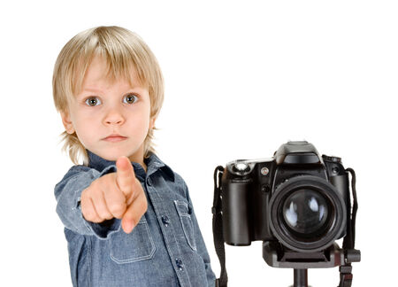 point and shoot: little boy with camera on tripod on white background