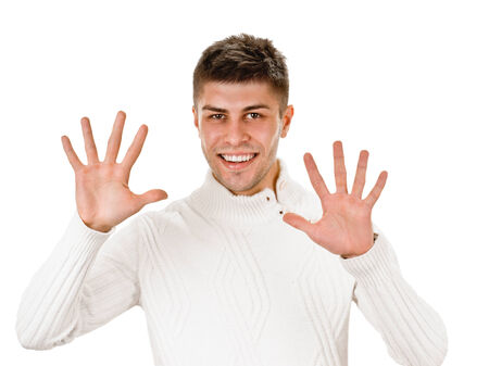 Portrait of happy smiling man showing ten fingers, isolated over white background photo