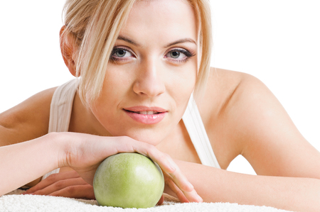 attractive female: blond woman with green apple. on white background