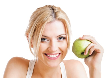 woman apple: blond woman with green apple.