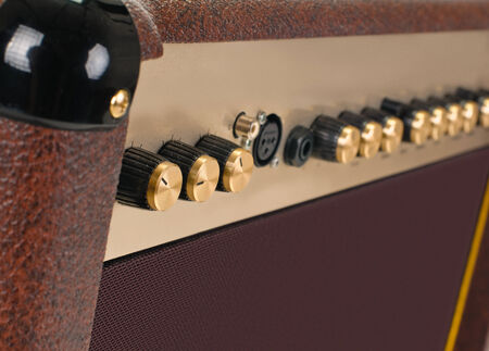 amplifier: top of the guitar amplifier without background