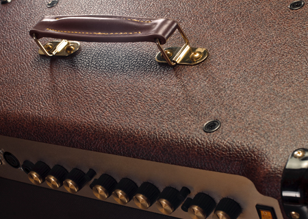 leatherette: handle on leatherette texture of an amplifier for electric guitar