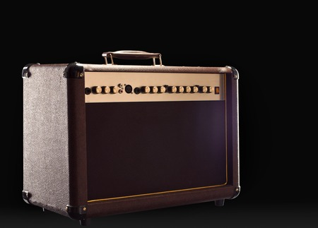 acoustic guitar amplifier on the dark background photo
