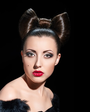 chignon: Fashion Model Girl Portrait. Creative Hairstyle. Hairdo. Make up. coiffure bow