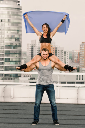 housetop: couple woman man exercising workout fitness aerobics on the house-top