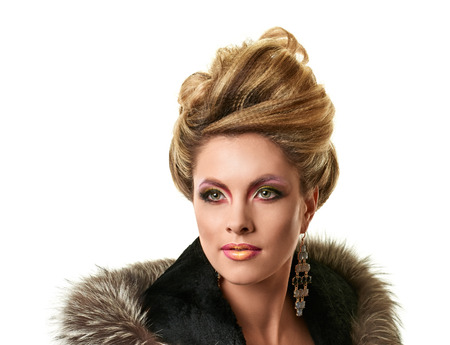 chignon: Glamour lady portrait in luxury fur coat. Beautiful model girl with fashion makeup and hairstyle.