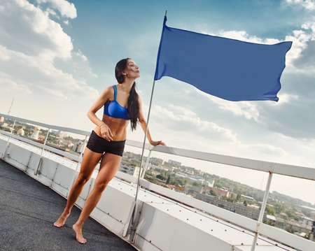 housetop: sport Female resting on the house-top with flag