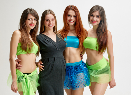 teaching adult: portrait of pregnant Choreographer and her dancers sisters triplets in studio