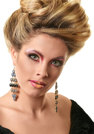 hair do: Glamour lady portrait. Beautiful model girl with fashion makeup and hairstyle.