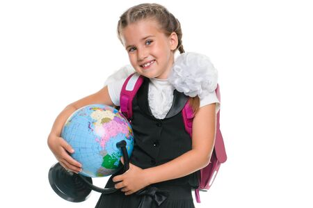 education and school concept - little schoolgirl with globe and backpack on white background photo
