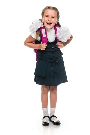 schoolgirl uniform: Little schoolgirl with a backpack full length isolated over white Stock Photo