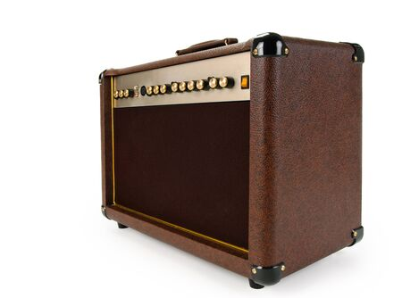 amp: brown Electric guitar amplifier on white background