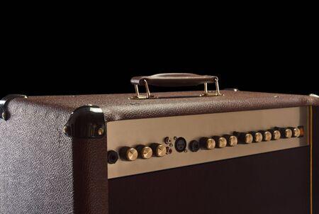 superdirecta: top of brown Electric guitar amplifier on black background Foto de archivo