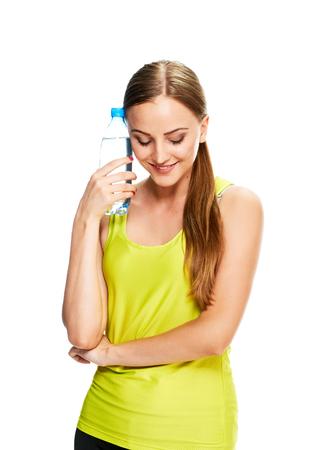 tomando agua: Mujer de la aptitud. Rubio con la botella de agua sobre fondo blanco.