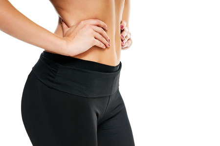 activewear: Close-up of torso of female holding on white