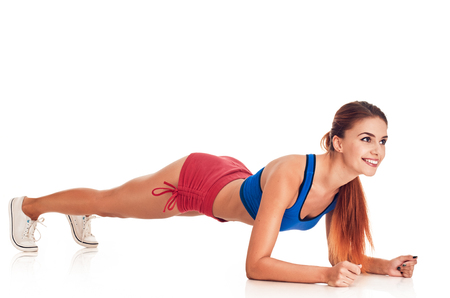 are slim: Slim fitness young woman Athlete girl doing plank exercise concept training workout crossfit gymnastics cross fit on white background Stock Photo