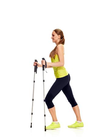Nordic walking - actieve mensen. vrouw in de studio op een witte achtergrond Stockfoto