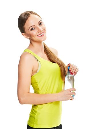 salud y deporte: Mujer de la aptitud. Rubio con la botella de agua sobre fondo blanco.