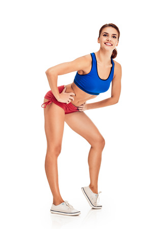 slim women: fitness woman. Young sporty Caucasian female model isolated on white background in full body Stock Photo