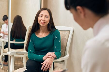 women talking: consulting woman patient with a doctor indoor