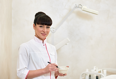cosmetologist: Portrait of a young medical worker cosmetologist indoor cabinet Stock Photo