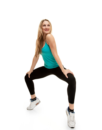 tiptoes: fitness woman. Young sporty Caucasian female model isolated on white background in full body. She is on tiptoes