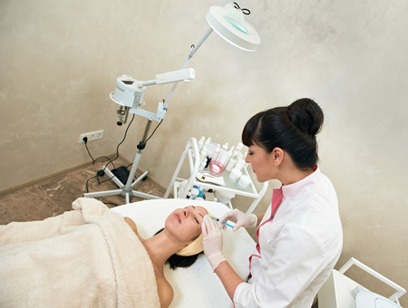 dermal: Young Woman Gets Cosmetic Dermal Filler Injection In Face In Beauty Salon. Reduction Of Wrinkles Treatment. Cosmetology. Beauty Face. Contouring Procedure. Mesotherapy