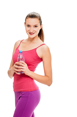 water sport: Fitness woman with bottle of water on white background. Stock Photo
