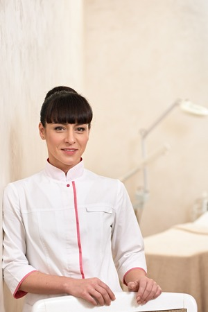 Portrait of a young medical worker cosmetologist indoor cabinet Standard-Bild