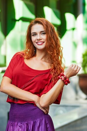 warm weather: pretty smiling woman at warm weather outdoor portrait