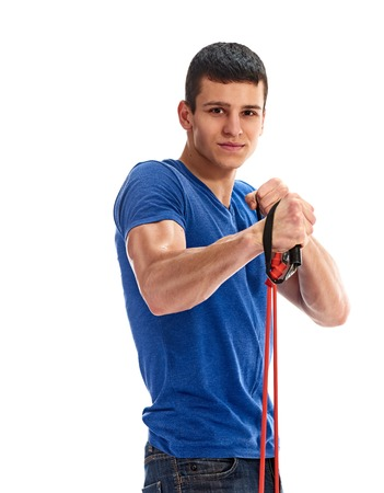 expander: fitness, sport, exercising, training and lifestyle concept - young man exercising with expander on white background Stock Photo