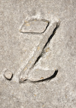 granite slab: Cyrillic symbol Z on granite slab. Ukraine Zolochev Carpathian