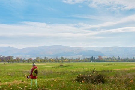 balkans: Landscape with the leaf fall. woman is on the foreground and Balkans mountine are on the background. Bulgaria Sofia. Stock Photo