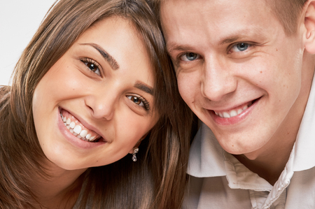 portait: Happy smiling couple laying laughing. close portait Stock Photo