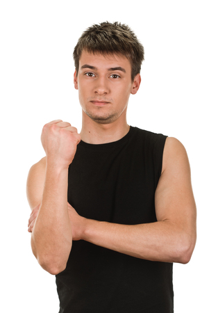 outrage: young man showing cubital sign. Synonym sign of middle finger