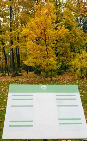 a public notice: notice board in autumn public park. Bulgaria Sofia Stock Photo