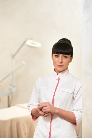 Portrait of a young medical worker cosmetologist indoor cabinet Stock Photo