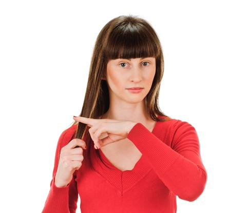 young woman is cutting her own hair by fingers. On white background