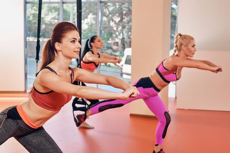 Group of women training at elastic rope in gym Stock Photo