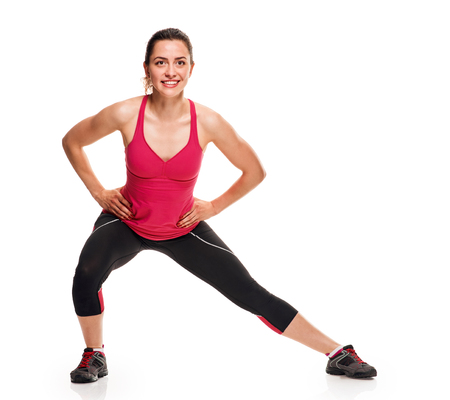 Lunge exercise fitness girl Stock Photo