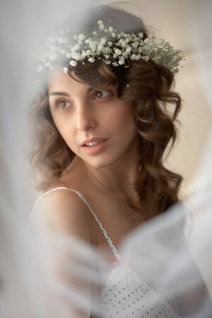 Sensual gently woman in wreath