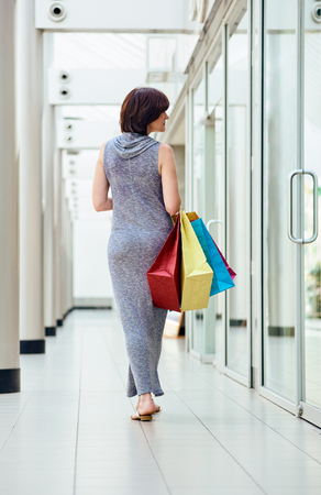 shopper: shopper with bags from back