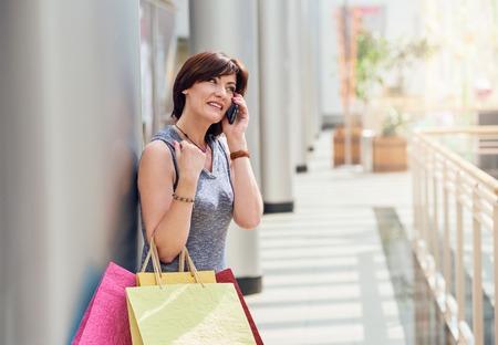 shopper: Shopper talking on smartphone