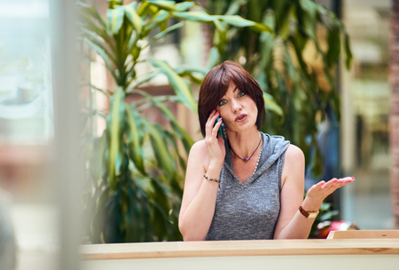 Woman talking on phone photo